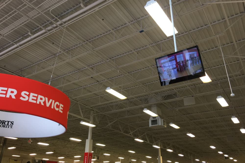 HD security camera monitor displayed at retail store entrance